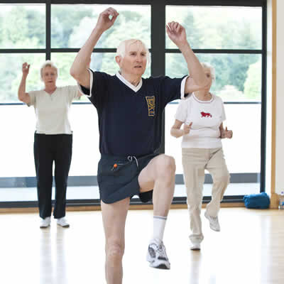 Group of older people doing an aerobics class