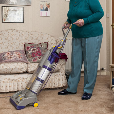 Mature lady hoovering
