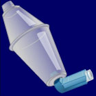 Metred dose inhaler with spacer